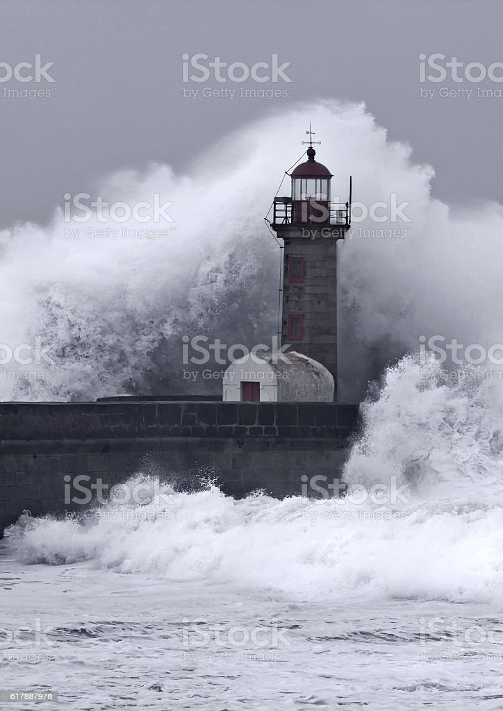 ten meters waves over the lighthouse stock photo