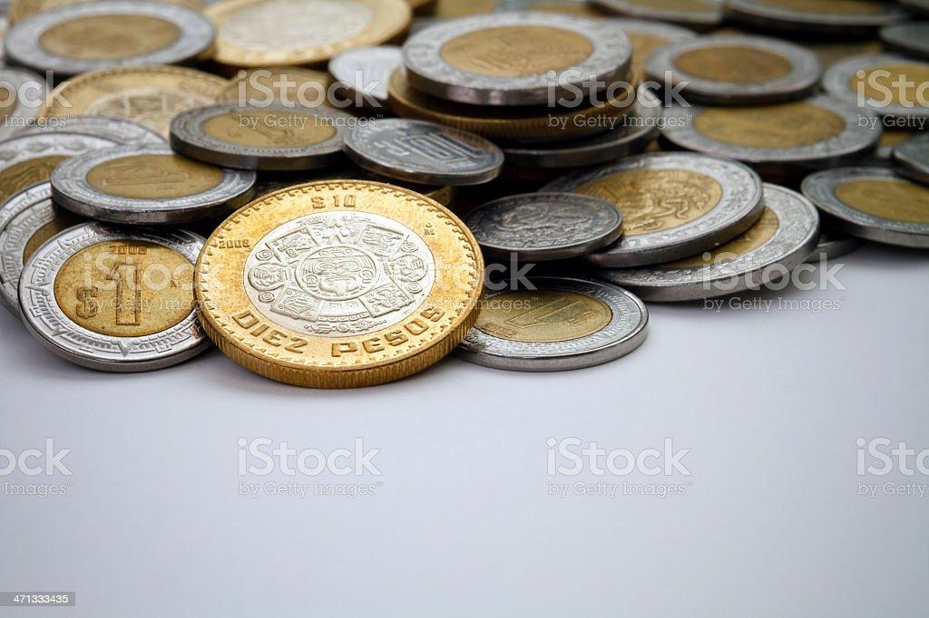 Ten Mexican Peso Coin Spot Lit Among Other Pesos stock photo
