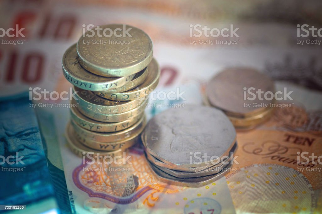 Ten pound and five pound notes and assorted coins stock photo
