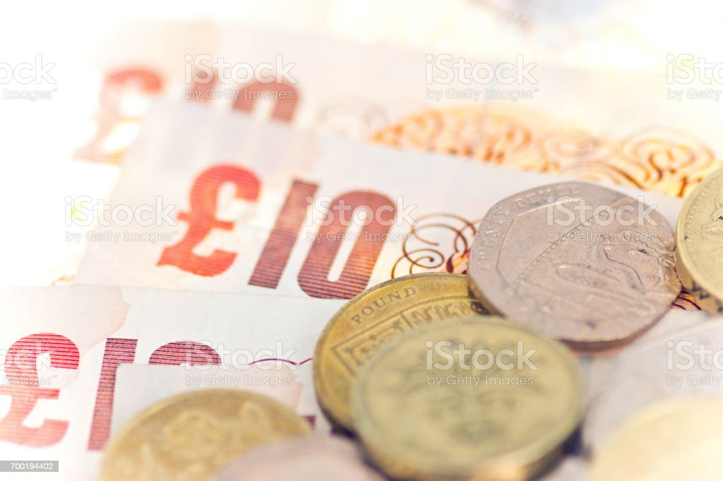 Ten pound notes and assorted coins stock photo