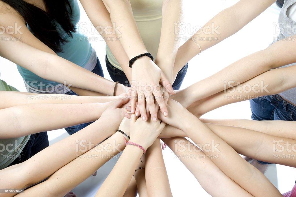 ten teenage girls joining hands royalty-free stock photo