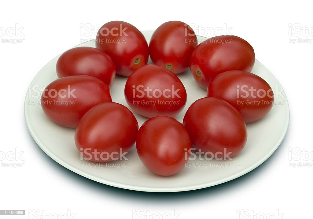 ten tomatoes on a dish royalty-free stock photo