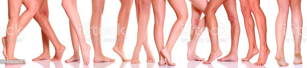 Ten women's legs in front of a white background stock photo