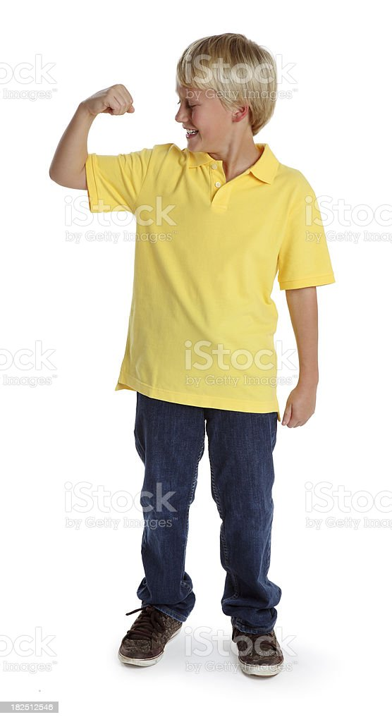 Ten Year Old Boy Flexing His Muscle stock photo