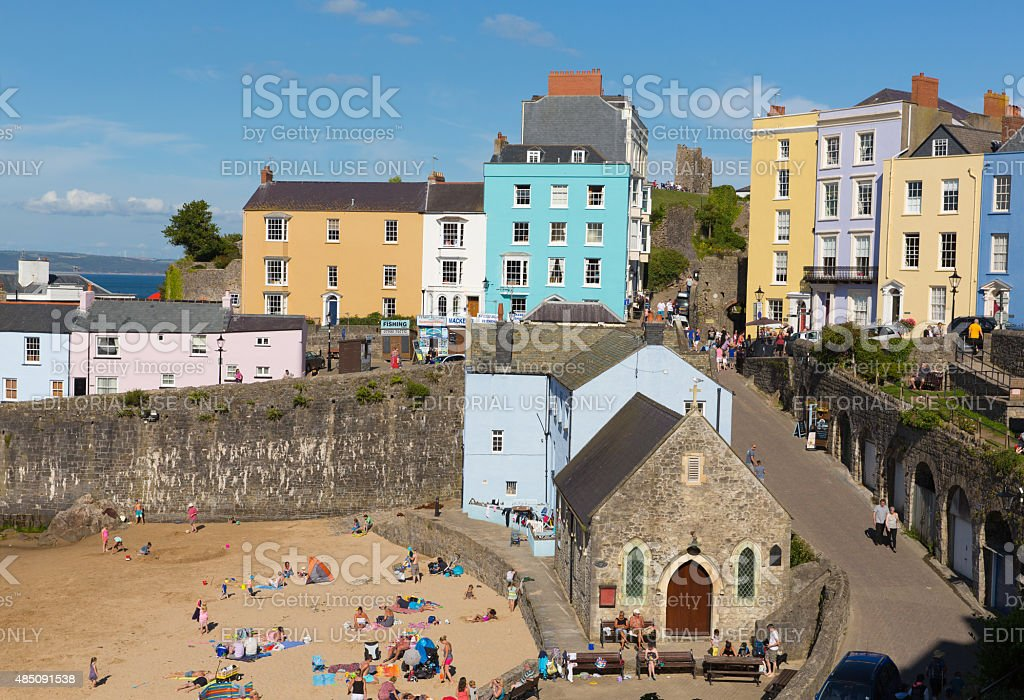 Tenby South Wales visitors enjoying summer weather and sun stock photo