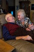 Tender moment between senior couples