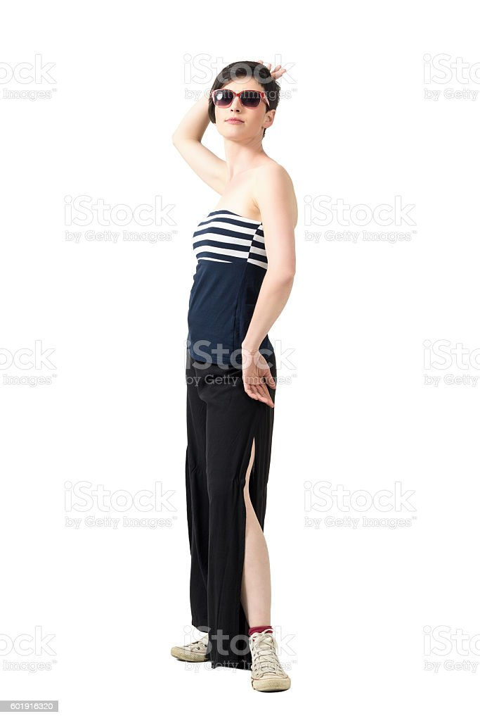 Tender young beauty in off shoulder top posing to camera stock photo