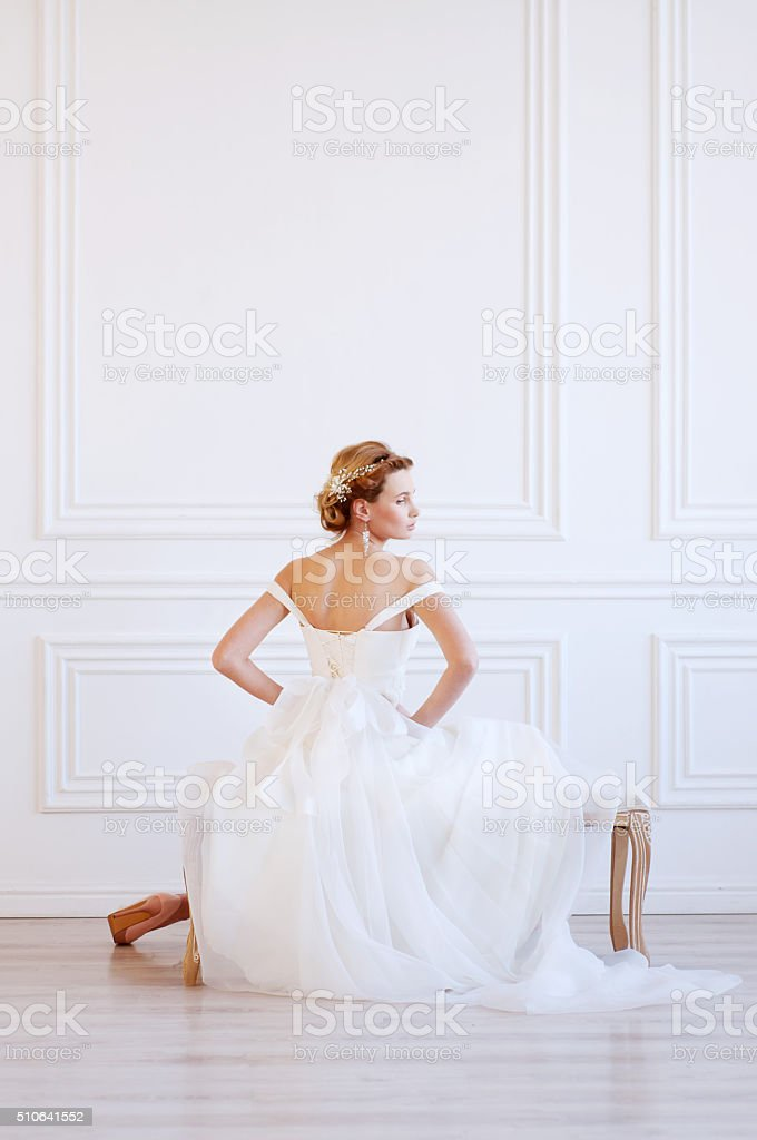 Tender young woman wearing headpiece stock photo