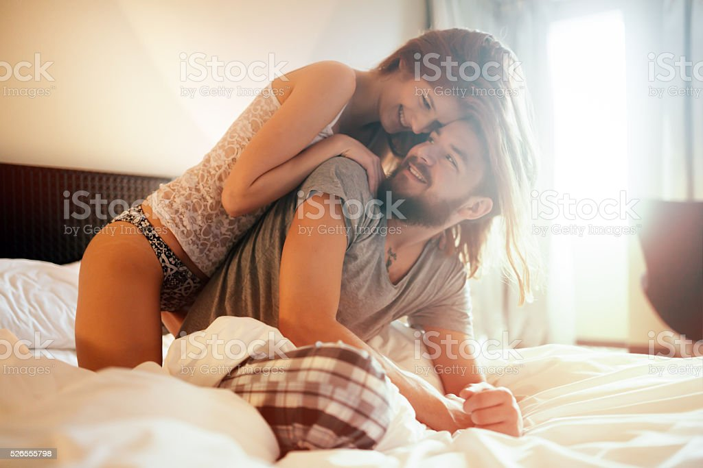 Tenderness od a beautiful couple in bedroom stock photo