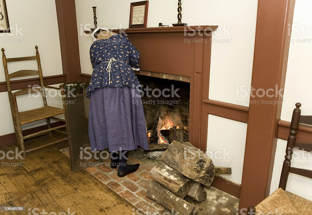 Tending the Fire royalty-free stock photo