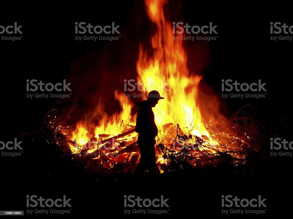 tending the fire stock photo
