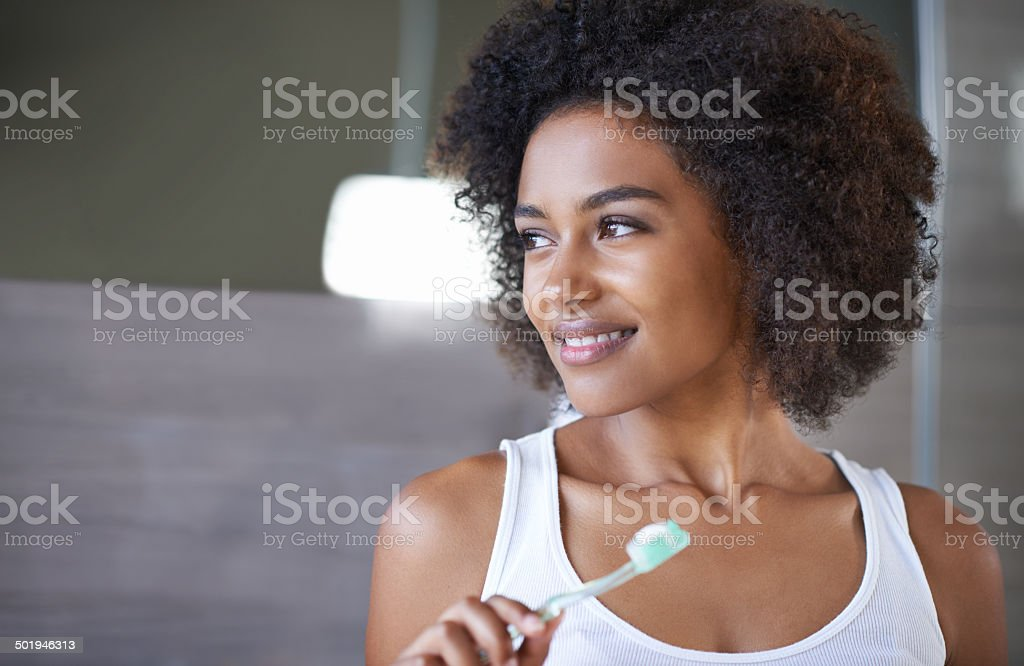Tending to her pearly whites stock photo