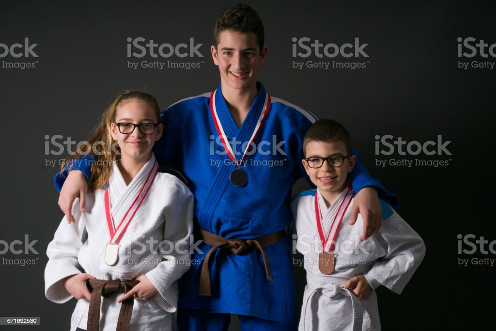 Teneger judo fighter boy and girl stock photo