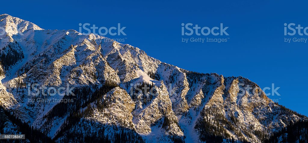 Tenmile Range Mountains in Winter at Sunset stock photo
