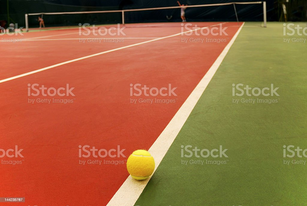 Tennis ball and court royalty-free stock photo