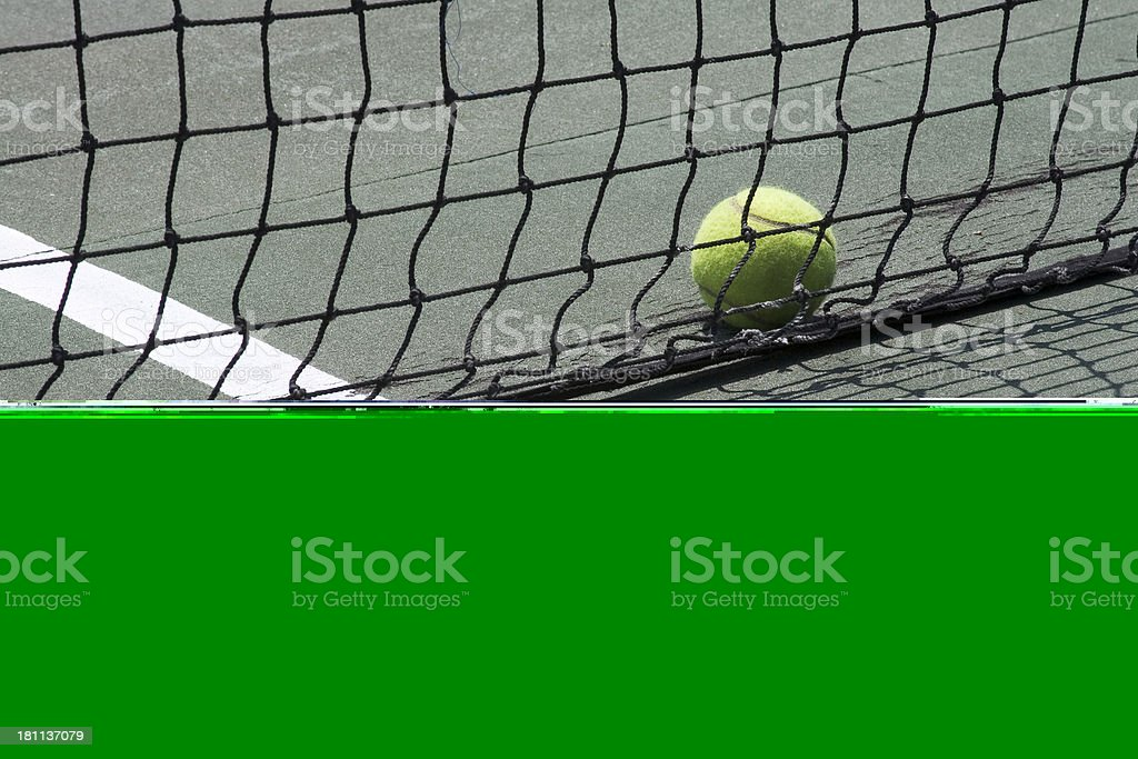 Tennis ball and net royalty-free stock photo