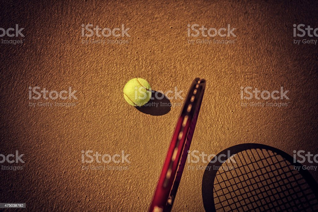 tennis ball and racket on hard court stock photo