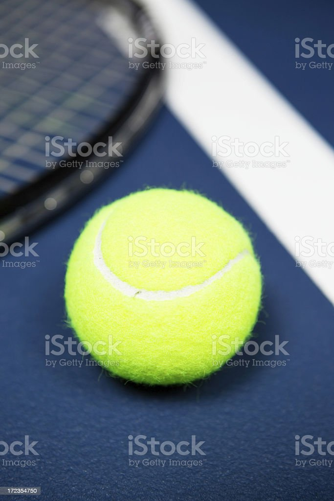 Tennis Ball and Racket on Indoor Court stock photo