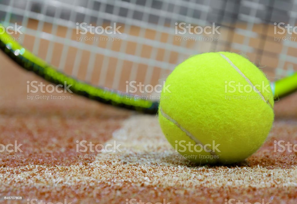 Tennis ball and racket on the court background stock photo