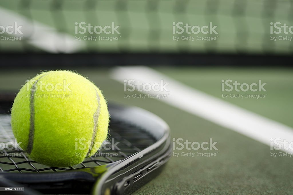 Tennis Ball and Racket on the Court Horizontal stock photo