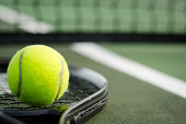 Tennis Ball and Racket on the Court Horizontal