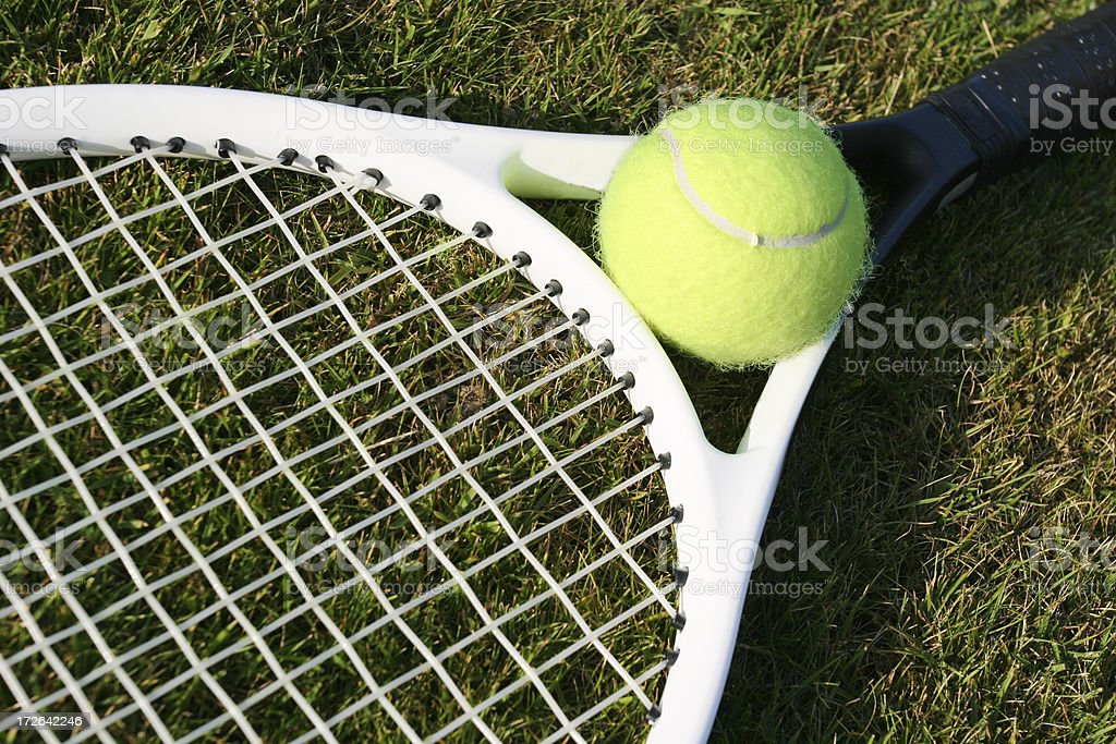 Tennis ball and racquet royalty-free stock photo