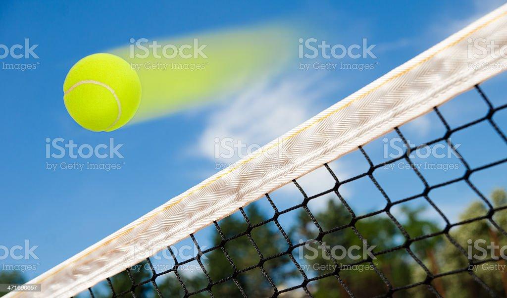 Tennis ball flying royalty-free stock photo
