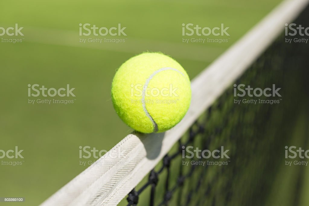 Tennis ball hitting the net stock photo