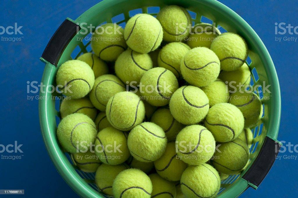 Tennis ball in basket royalty-free stock photo
