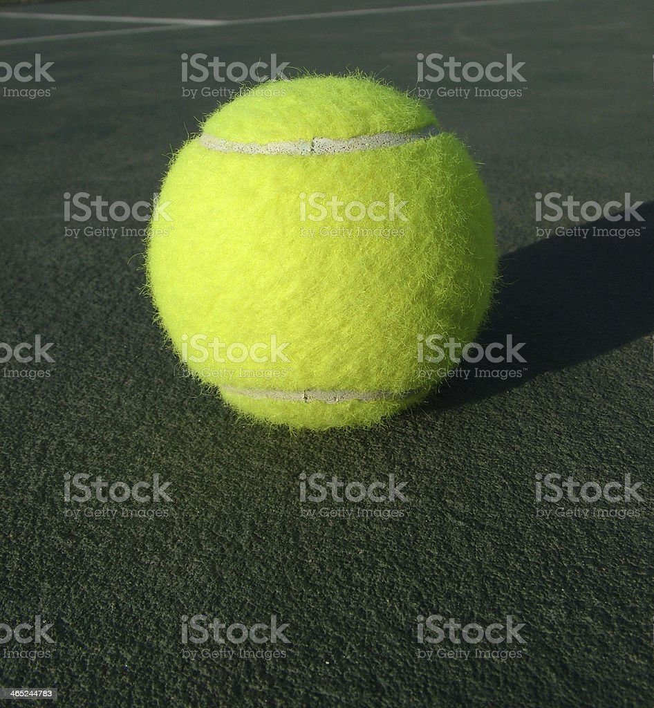 Tennis ball in court royalty-free stock photo