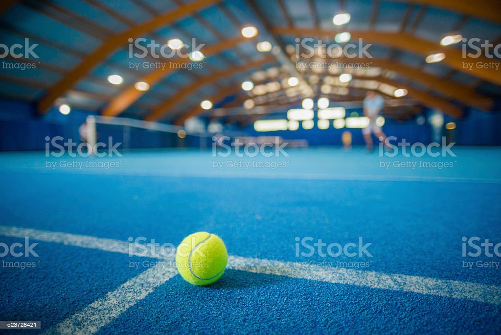 Tennis Ball in Indoor Court stock photo