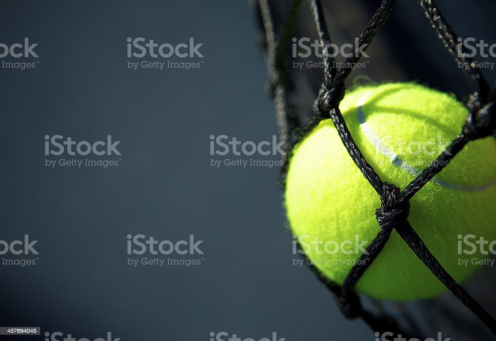 Tennis Ball in the Net royalty-free stock photo