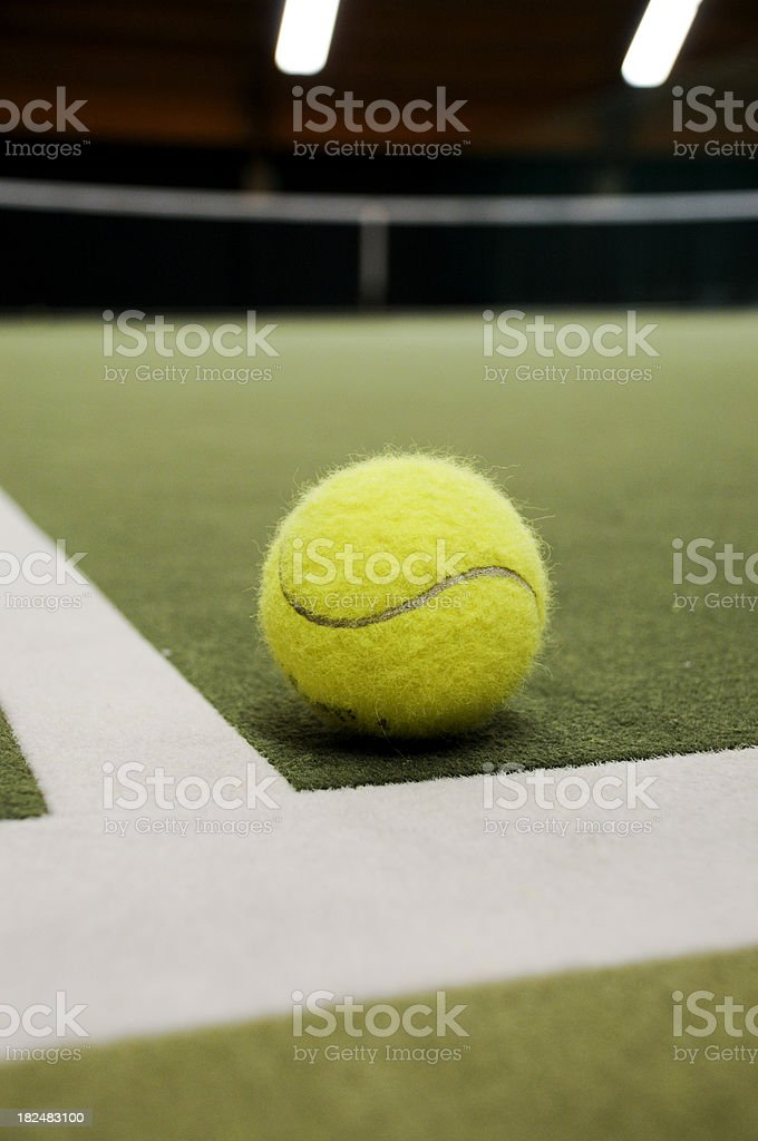 Tennis ball inside vertical royalty-free stock photo