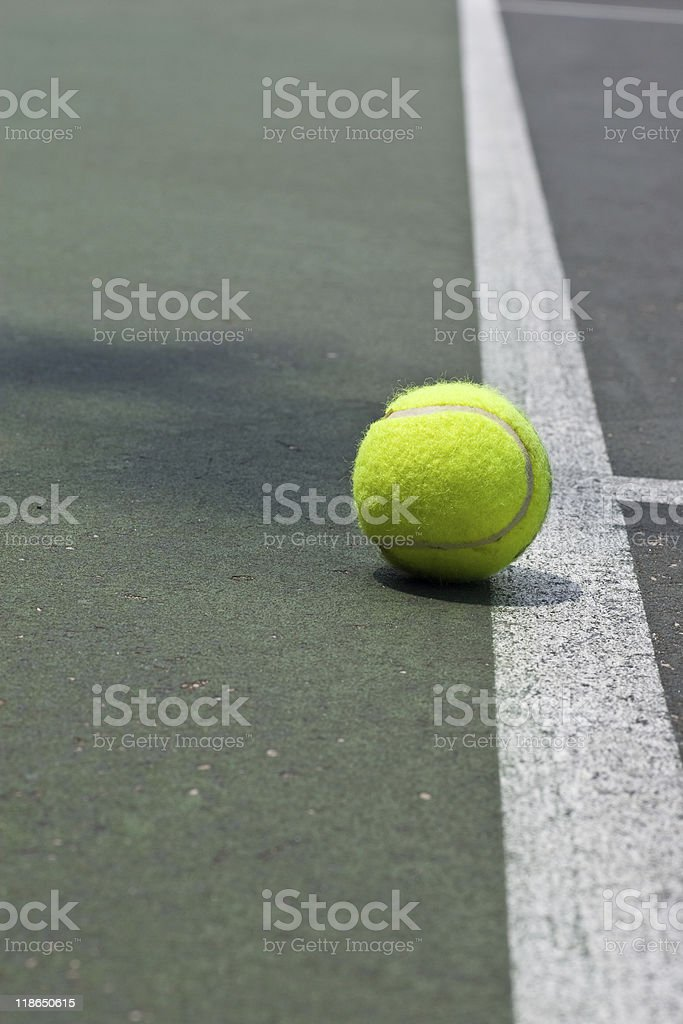 Tennis ball just beyond the base line stock photo