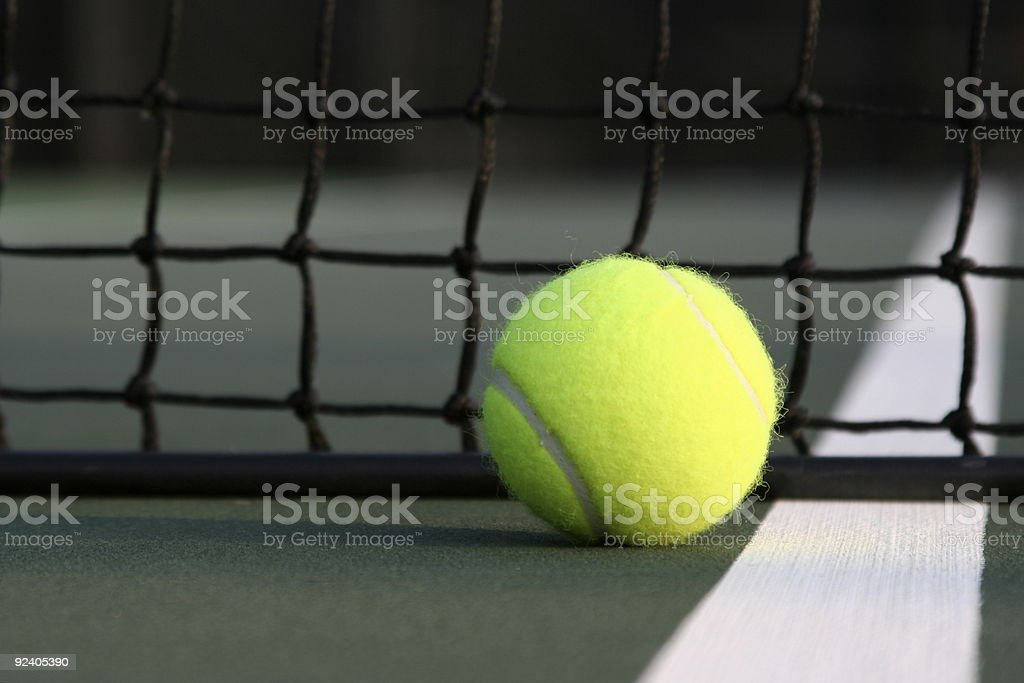 Tennis Ball near the Court Net
