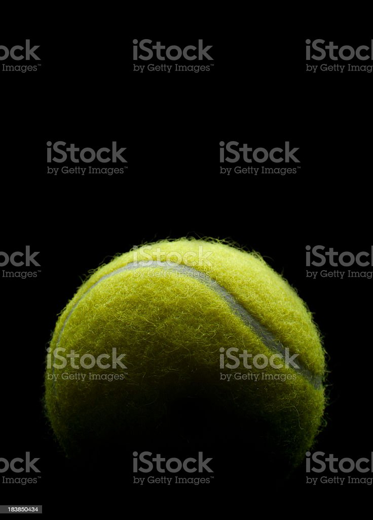 Tennis ball on a black background stock photo