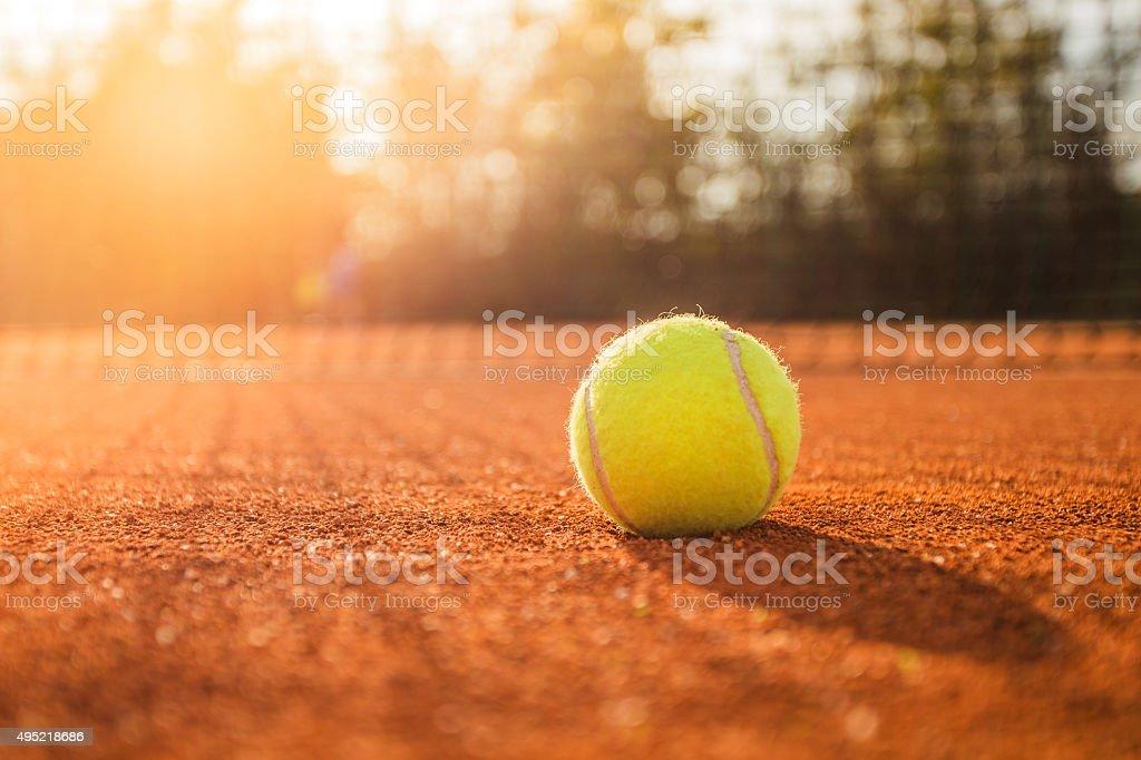 Tennis ball on a court stock photo