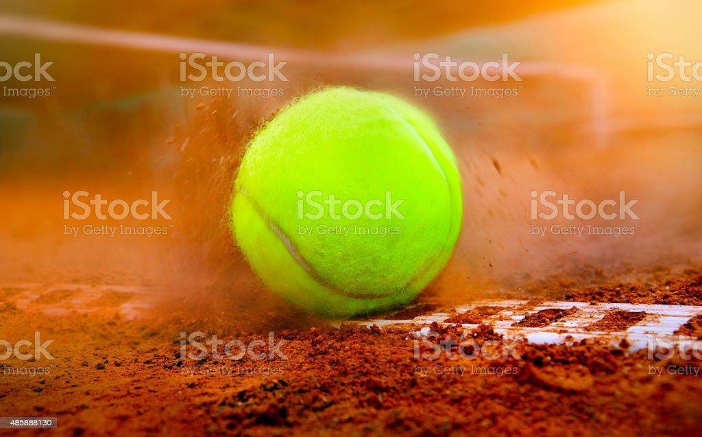 tennis ball on a tennis court stock photo