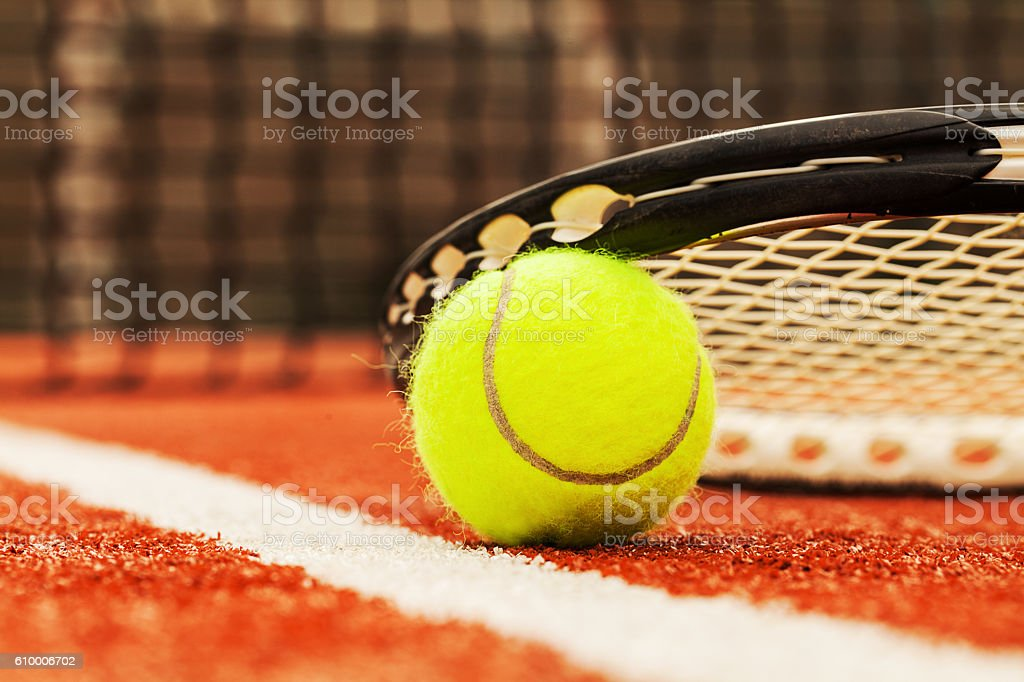 tennis ball on a tennis court stock photo