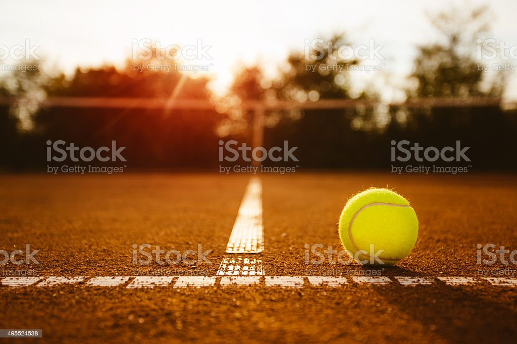 Tennis ball on clay court stock photo