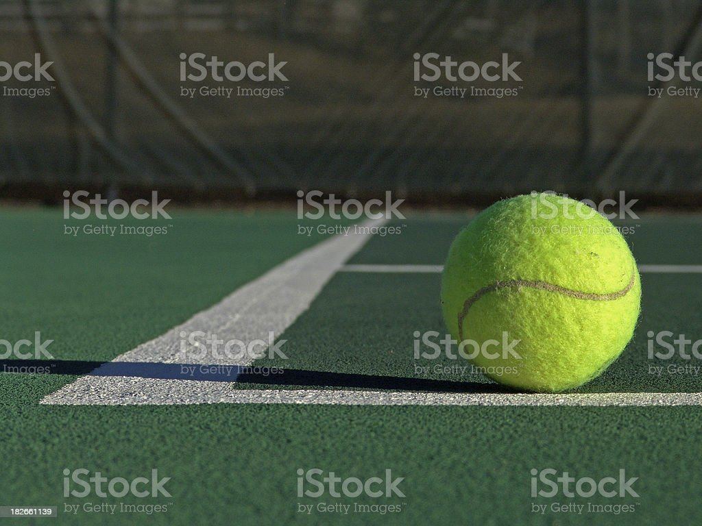 Tennis Ball on Court royalty-free stock photo