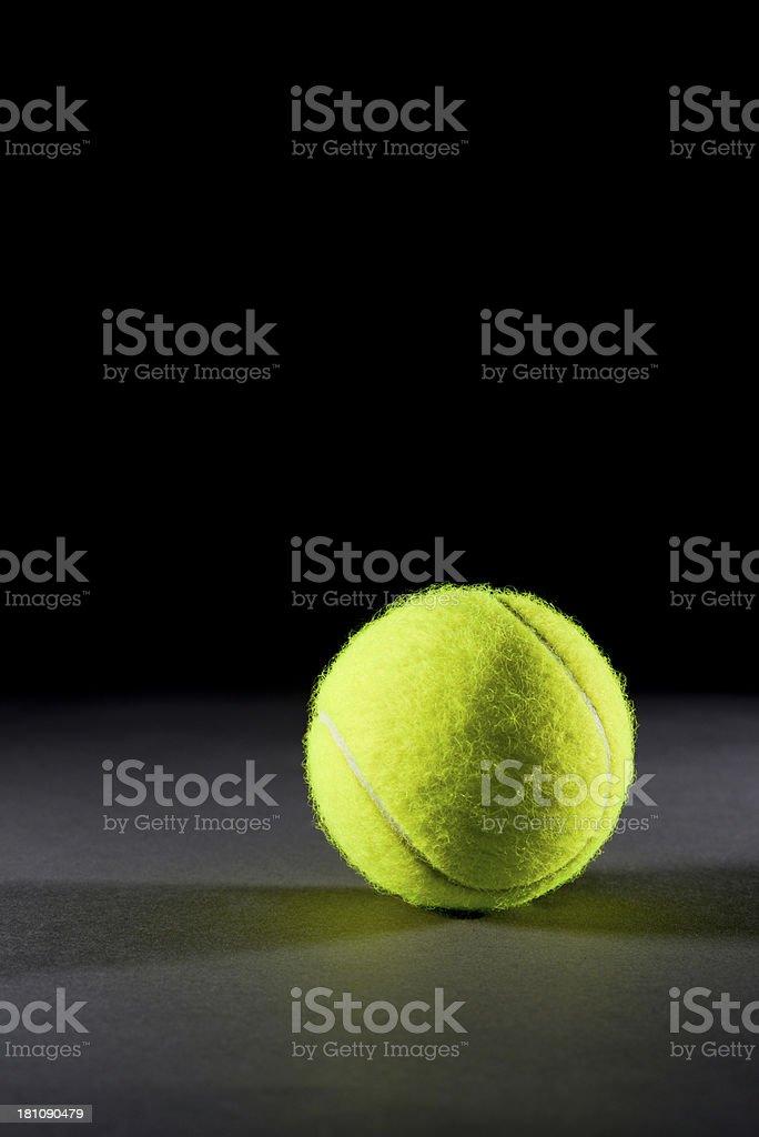 Tennis ball on dark background royalty-free stock photo