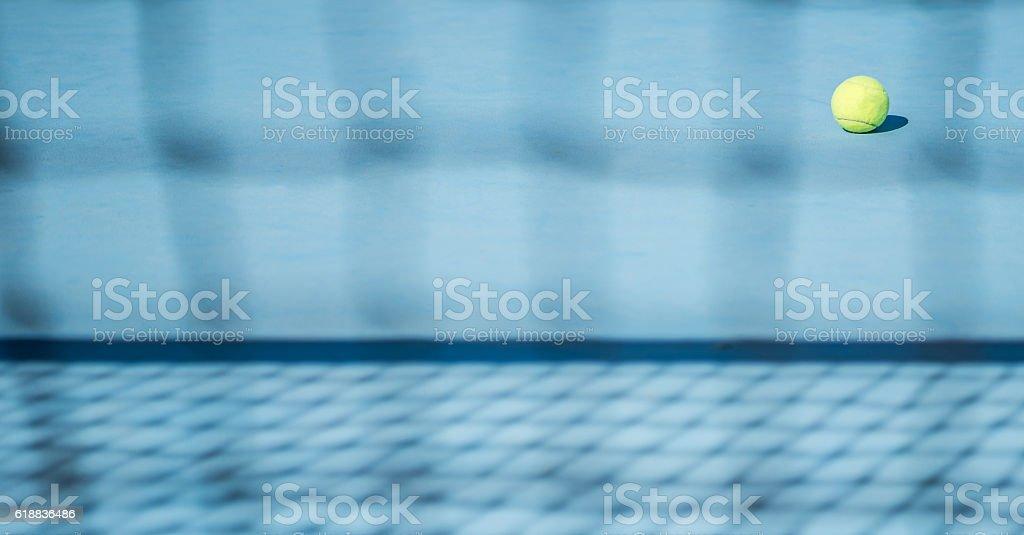 tennis ball on floor stock photo