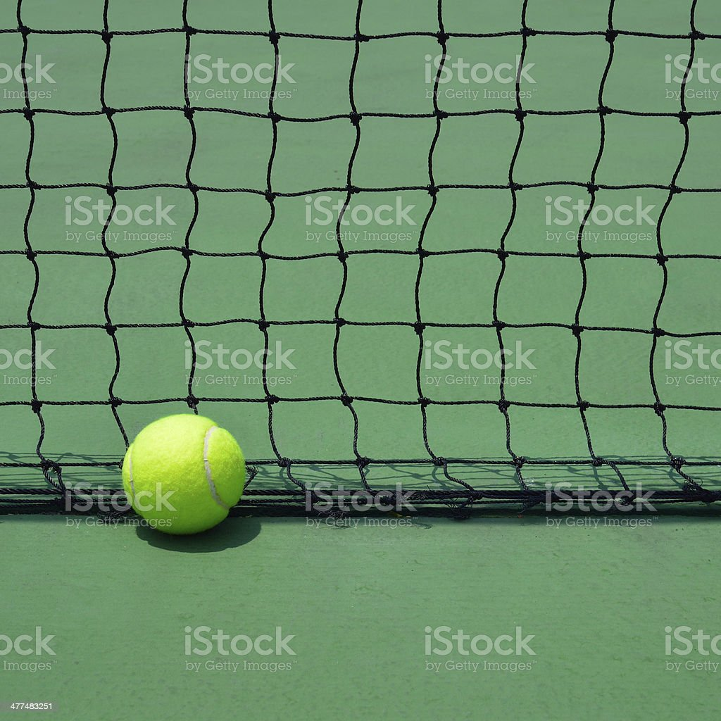 tennis ball on green court royalty-free stock photo