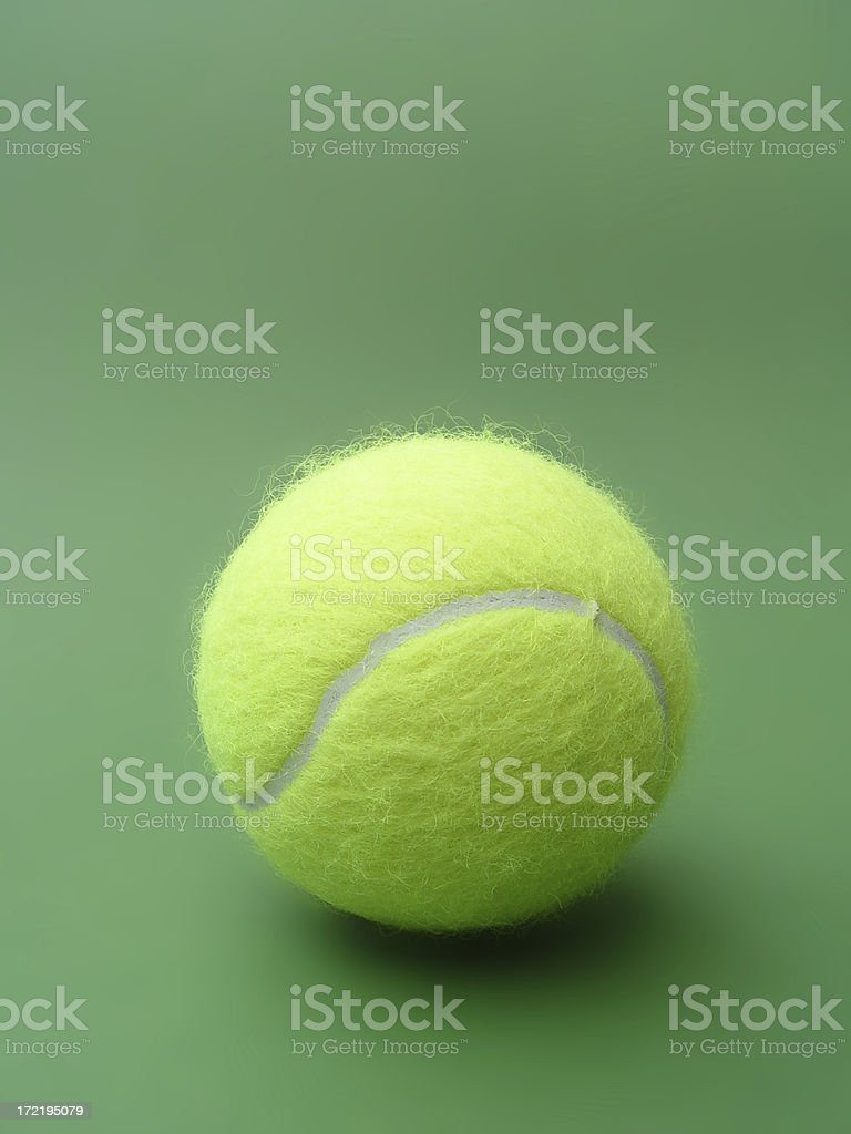 tennis ball on green stock photo
