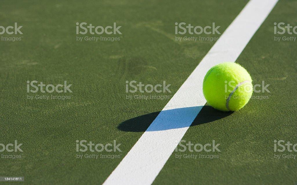 Tennis ball on line. stock photo