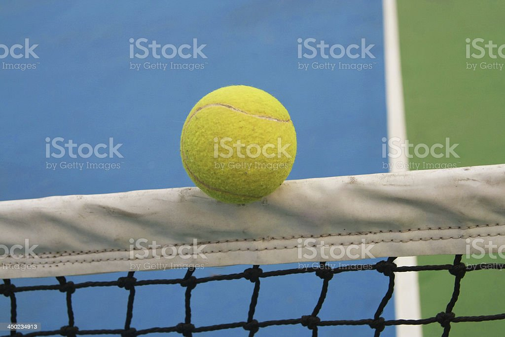 tennis ball on net stock photo