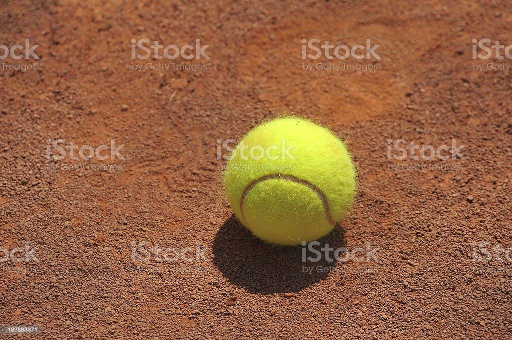 Tennis Ball on red slag royalty-free stock photo