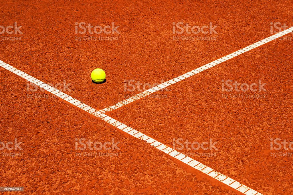 Tennis ball on tennis court. Clay surface. stock photo