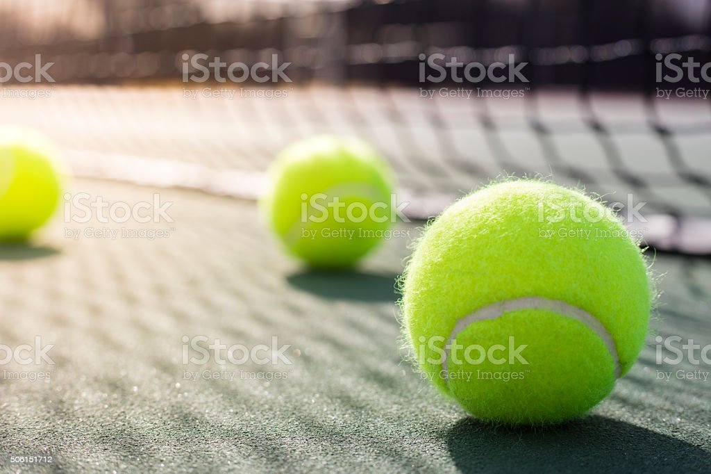 Tennis Ball on Tennis Court stock photo